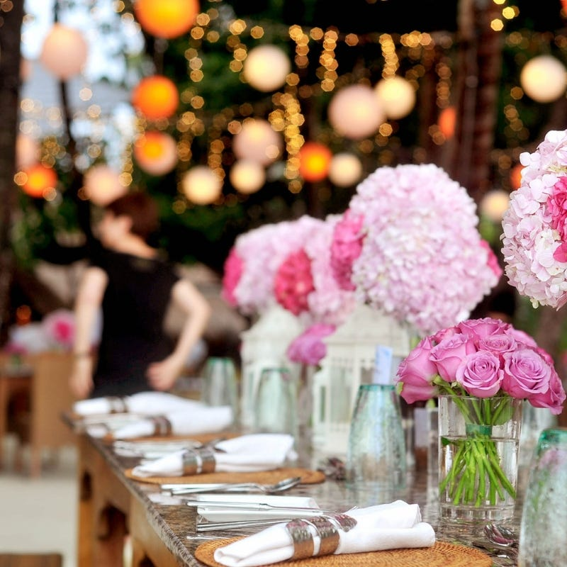 Party planning for a formal event with flowers on table