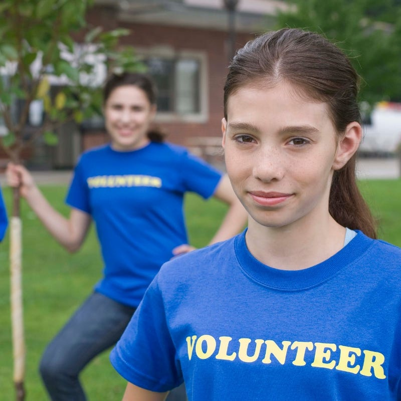 A young girl volunteering in her local community