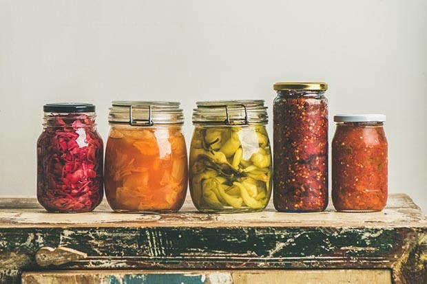 5 jars with colorful pickles inside