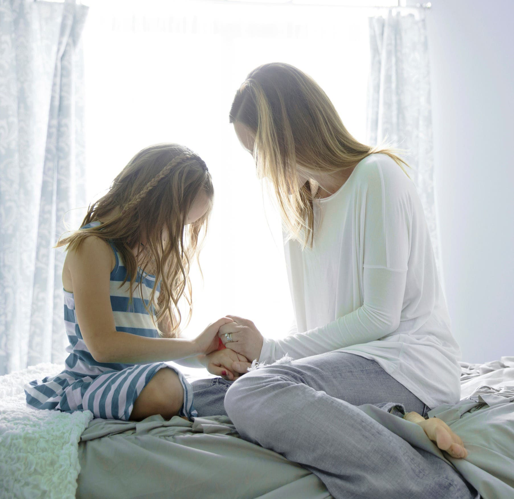 Girl and mom praying