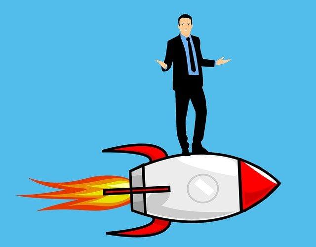 Cartoon image of man standing on rocket