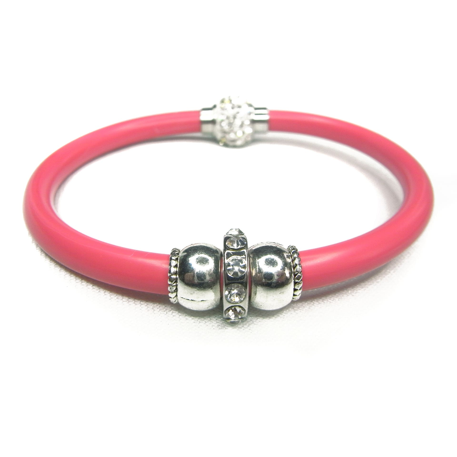 Pinky-red resin bracelet threaded with silver beads.