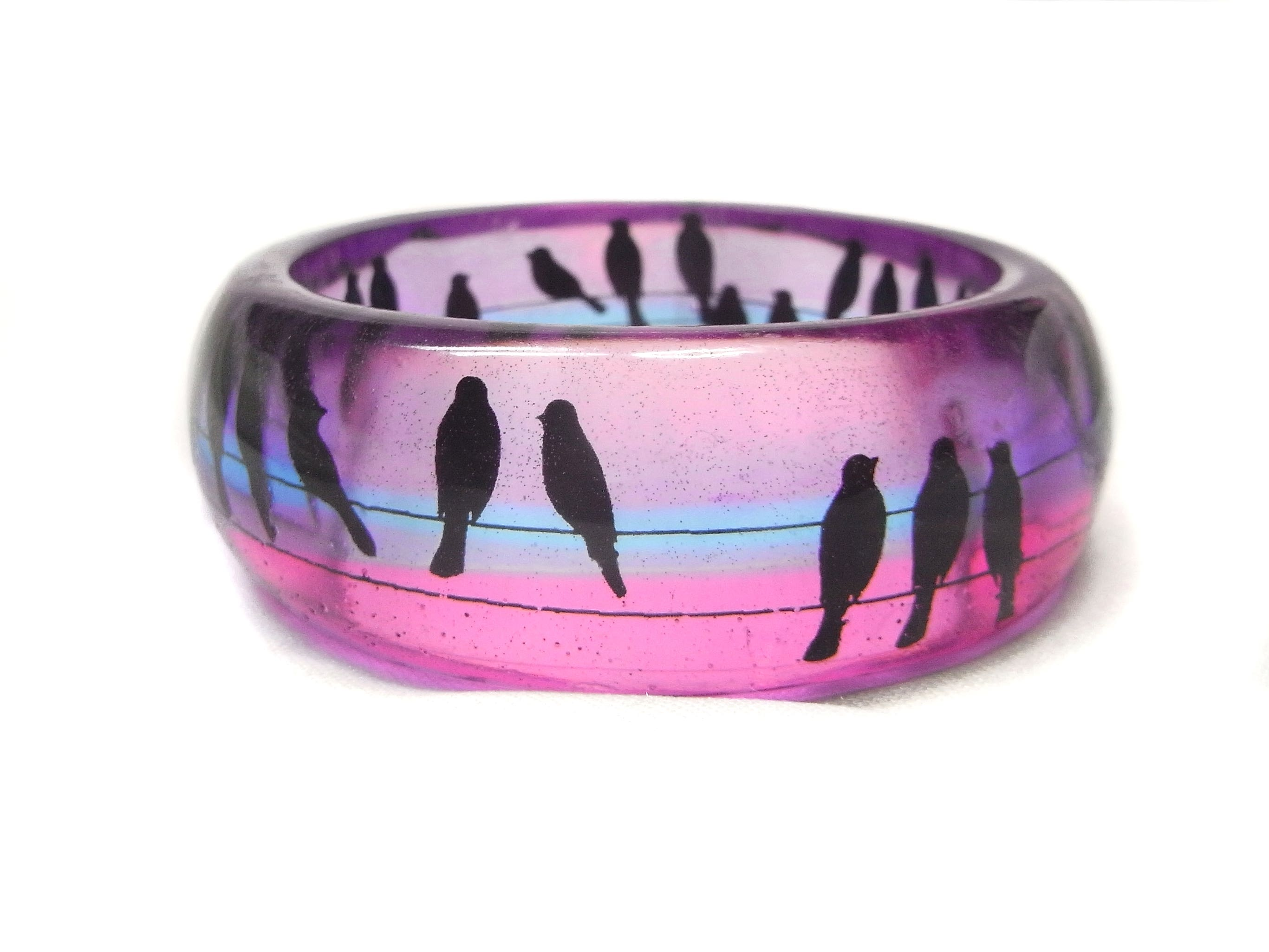 Turquoise feathers in clear resin bangle and orange pink and red feathers in clear resin bangle
