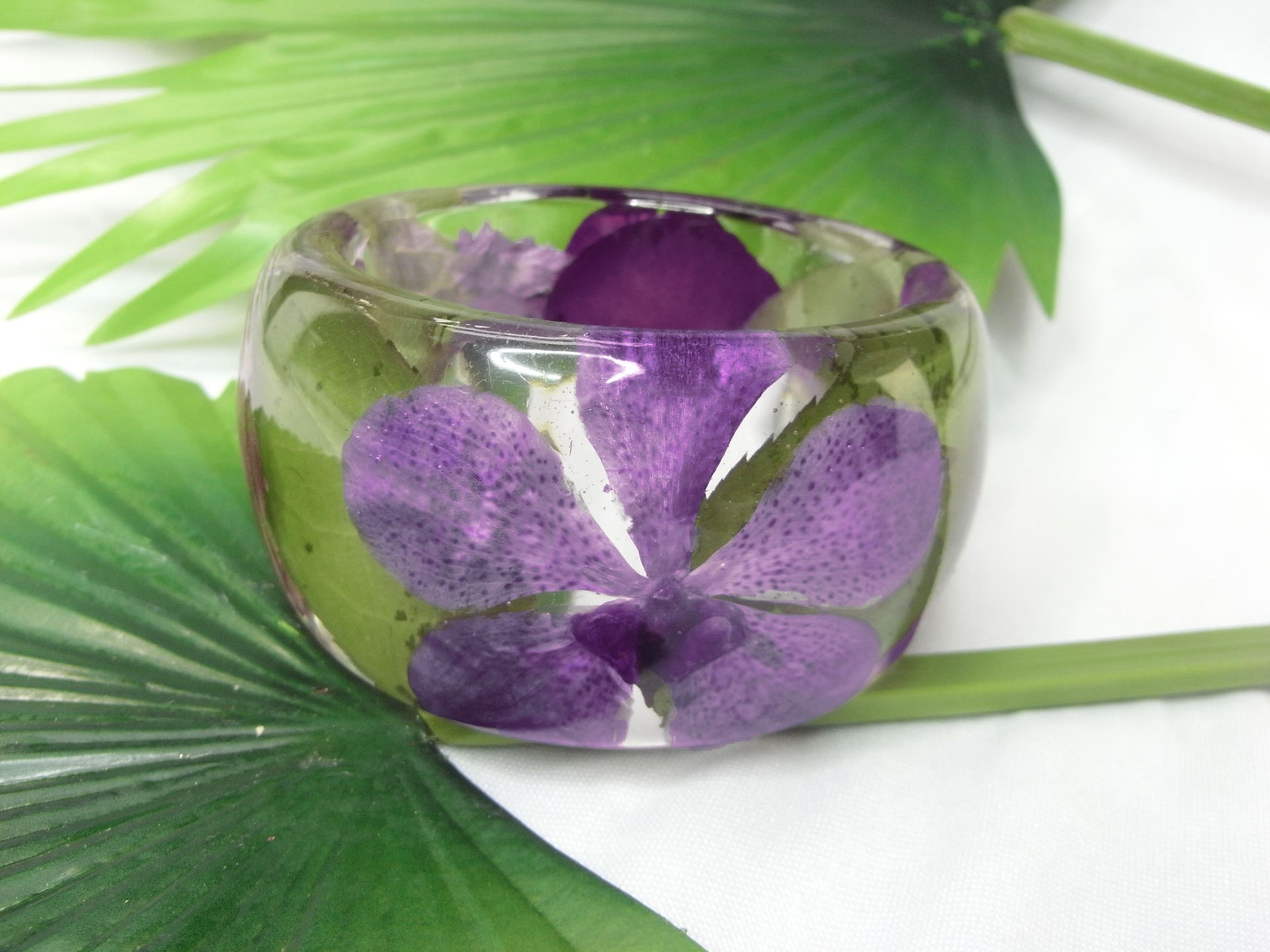 Clear resin bangle filled with purple Vanda orchids