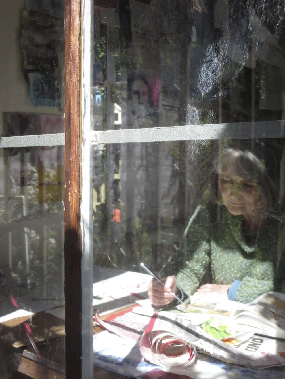 Cas Holmes working in her studio