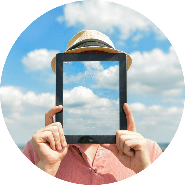 Man holding iPad in front of his face to mimic clouds background