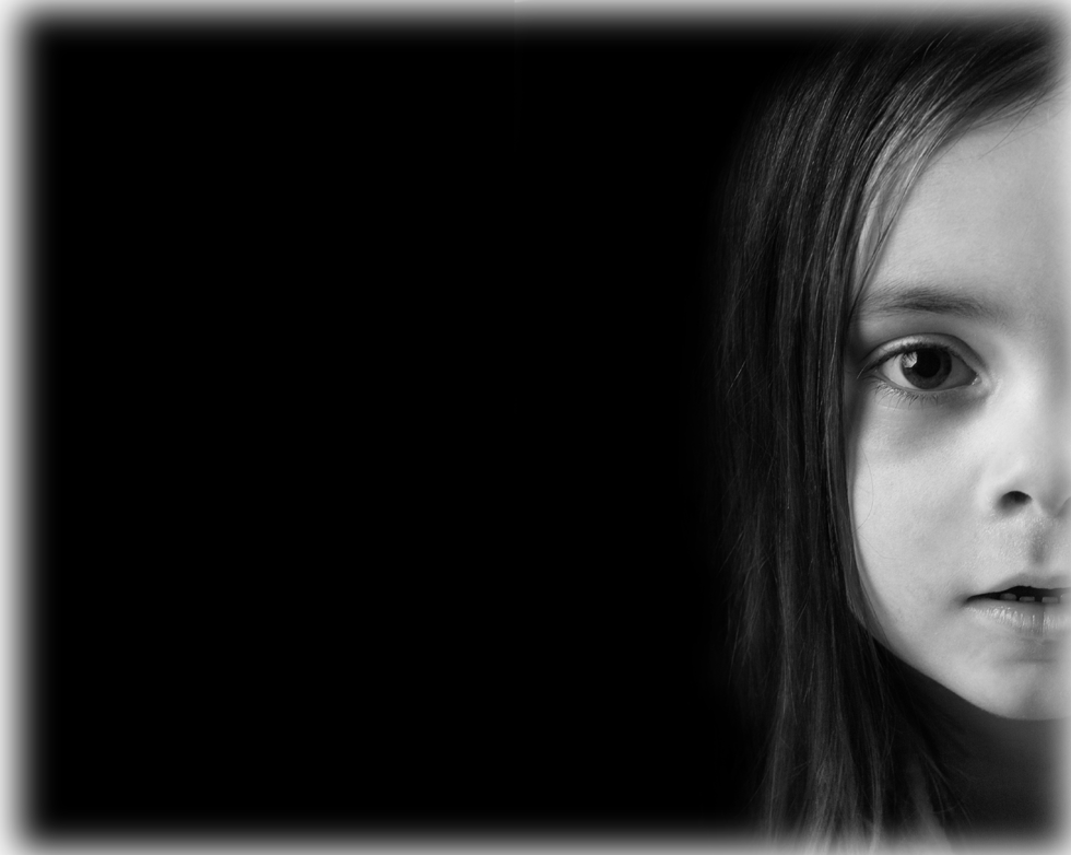 a black and white photo of a little girl.