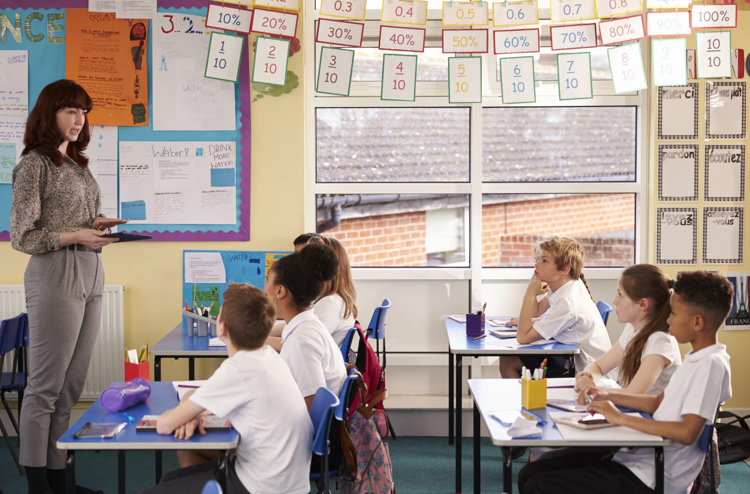 In classroom teacher instructing students