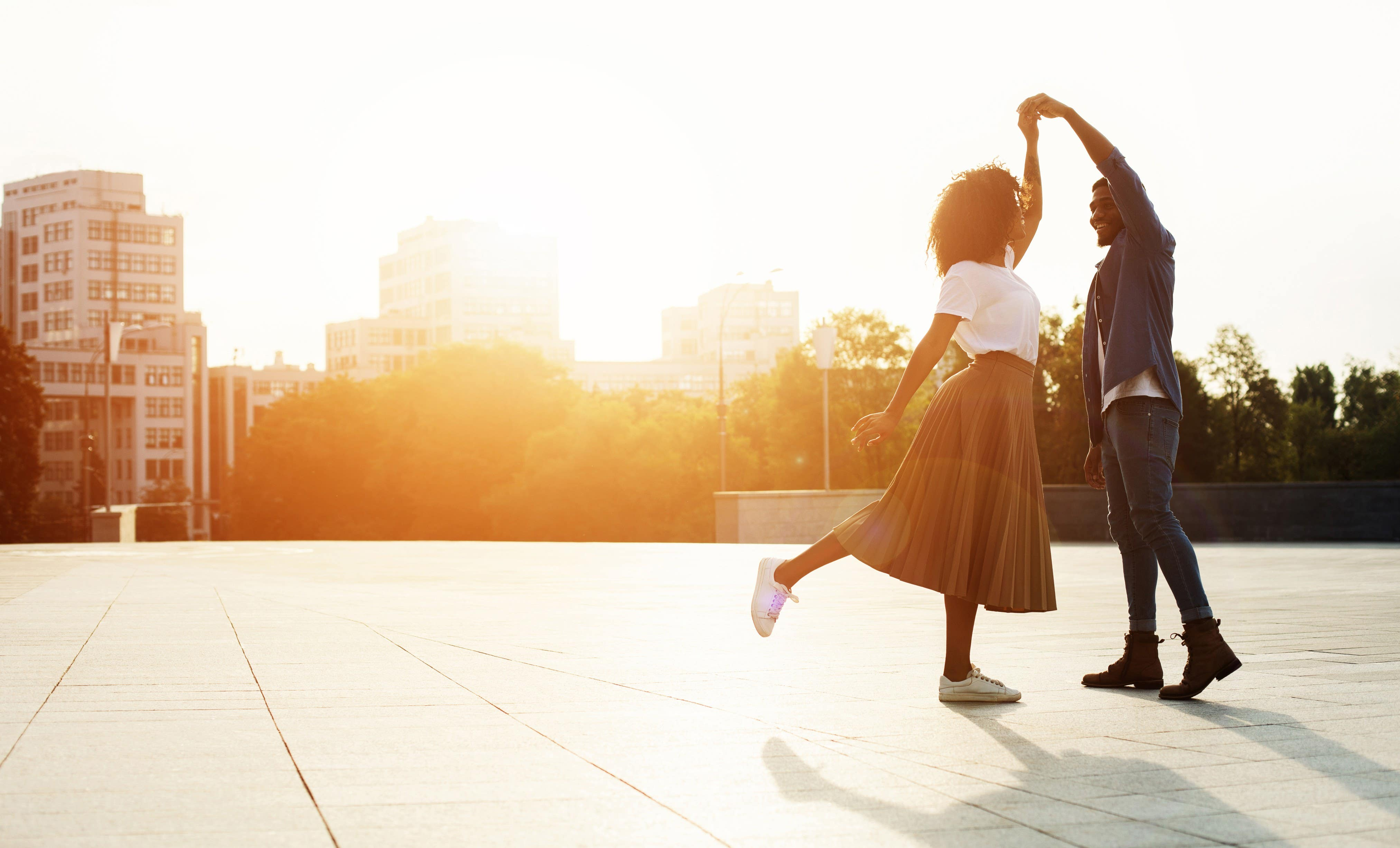 Happy, dancing couple after weight loss