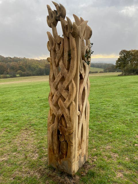 flame celtic wood carving with tree in it