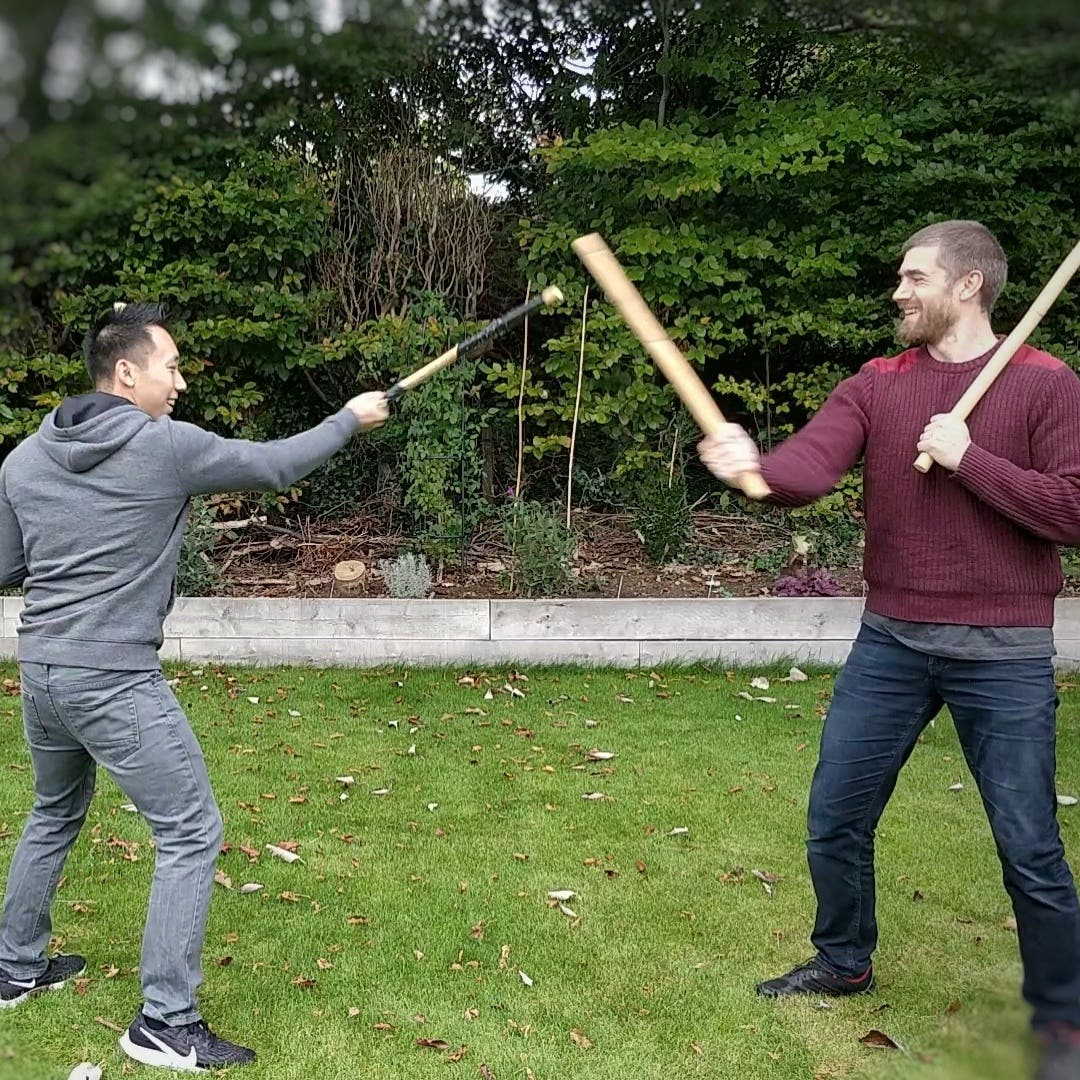 two filipino martial artists training double stick