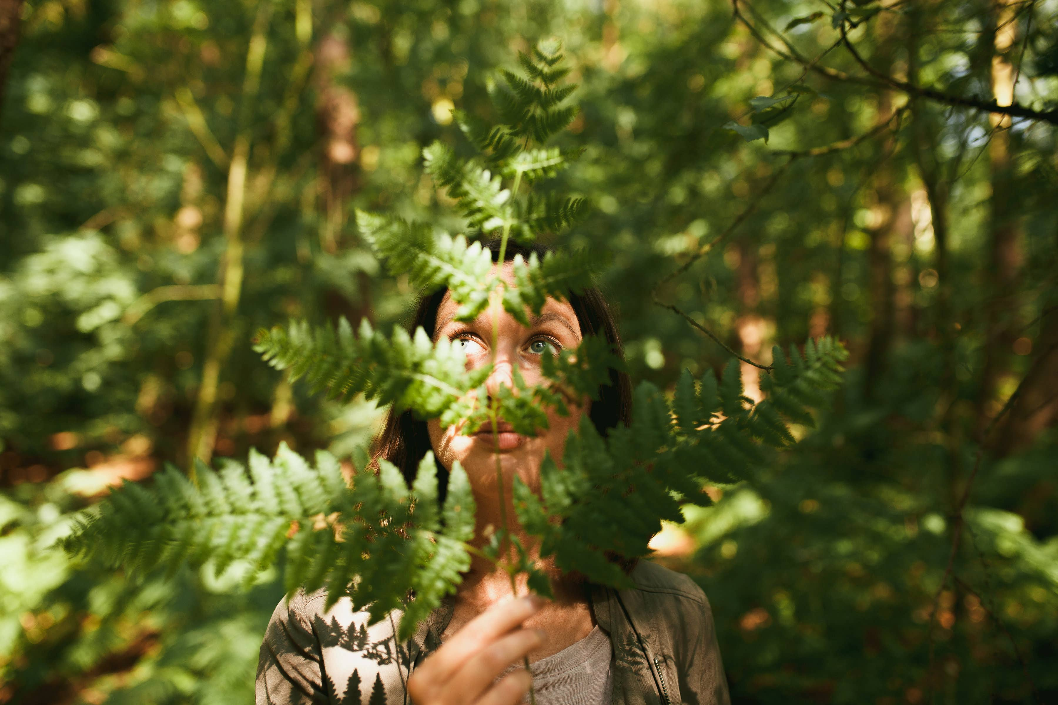 Woman holding a fern