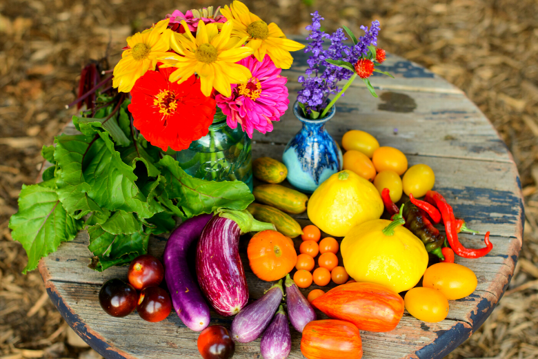 colorful garden harvest of vegetables and flowers