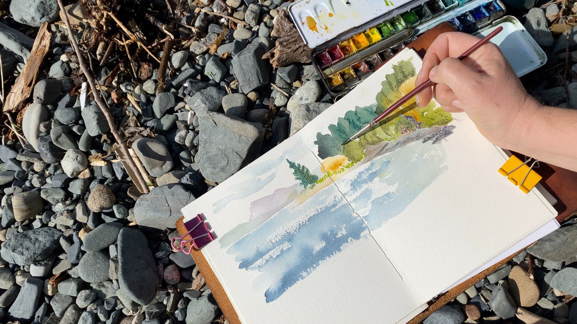 Painting a bay with watercolour