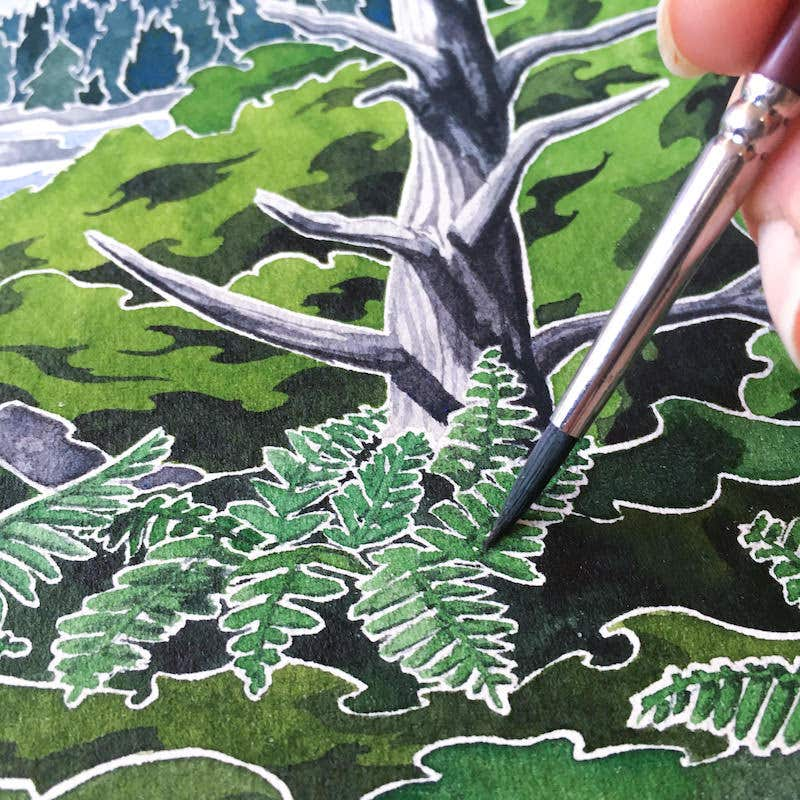 Painting ferns with a small paintbrush