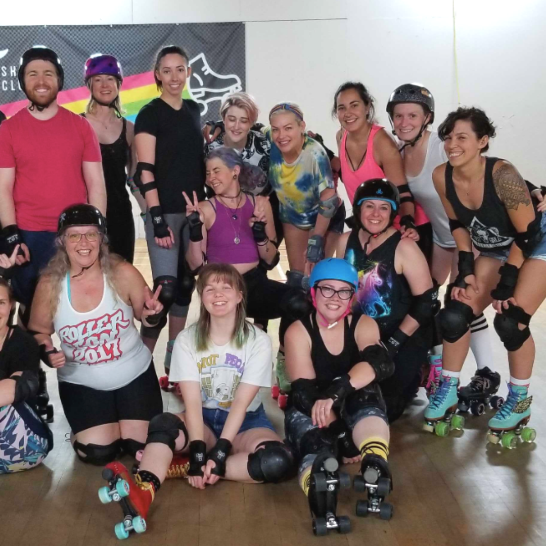A group of rollerskaters smile after a fun class