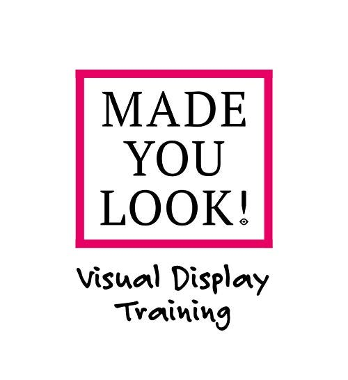 Made You Look! Visual Merchandising & Display Academy. Image of  mannequins, stack of ribbons, diamonds and notebook in cerise and black
