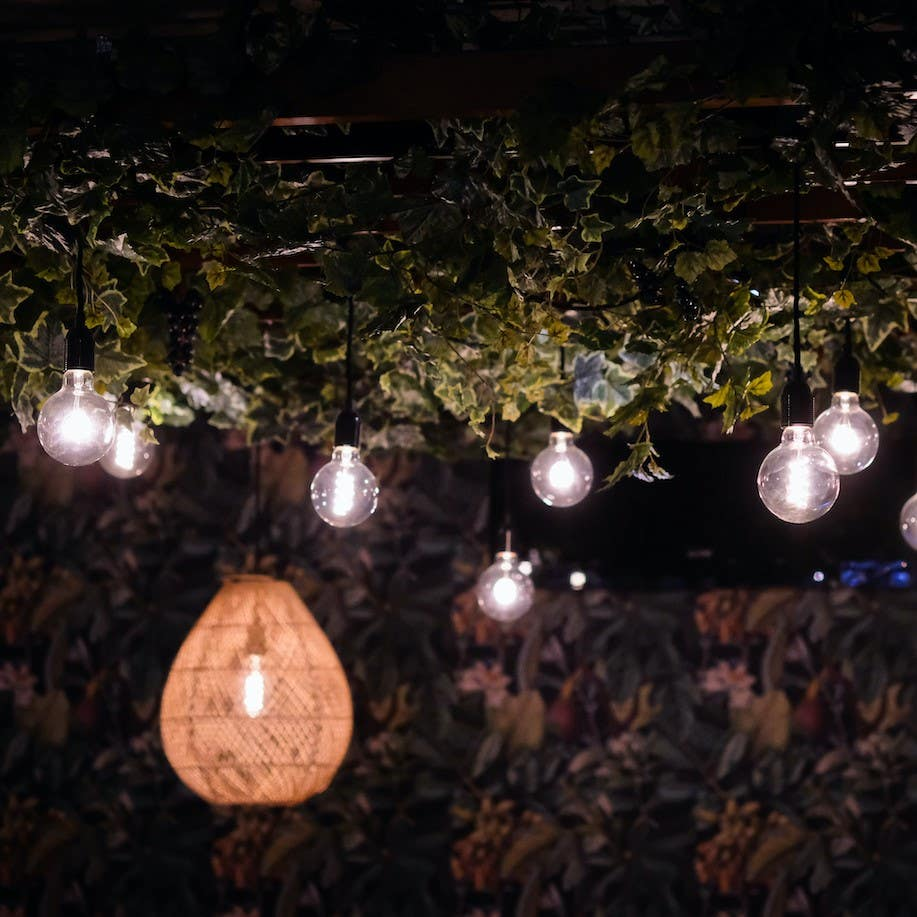 Creating mood transforming a concrete ceiling in a wine bar