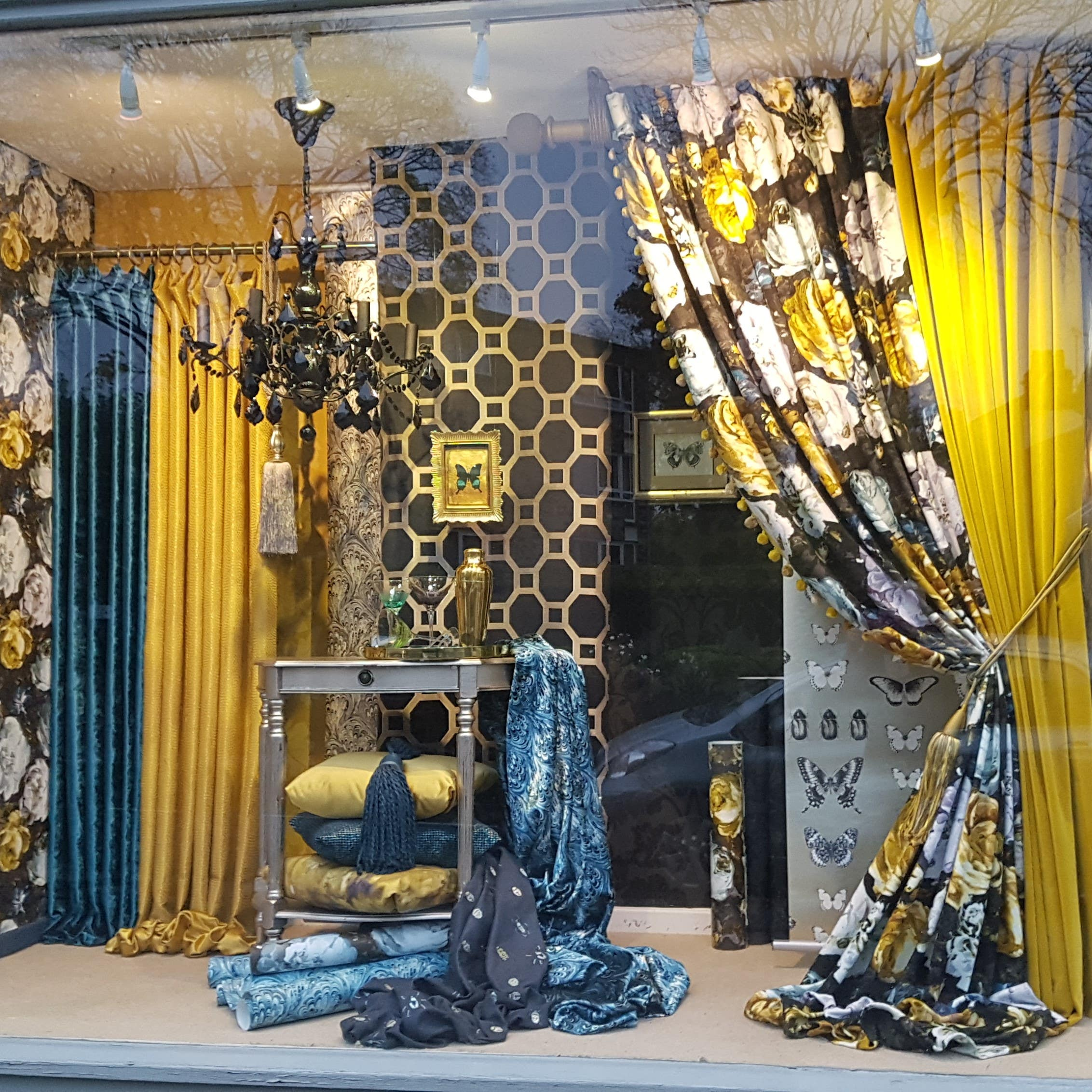 Interior furnishing display created from fabrics and wallpapers