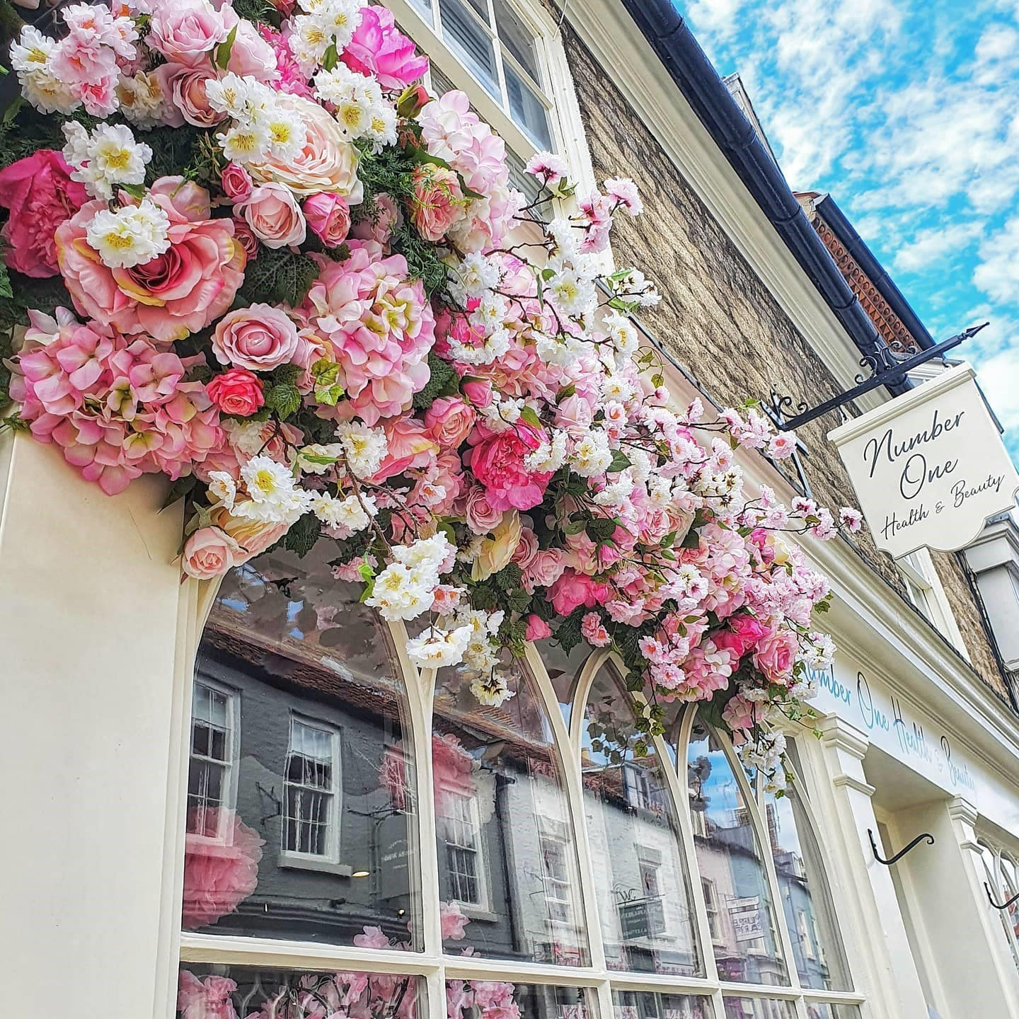 Possibilities for the outside of your business. Flowers will always attract attention!