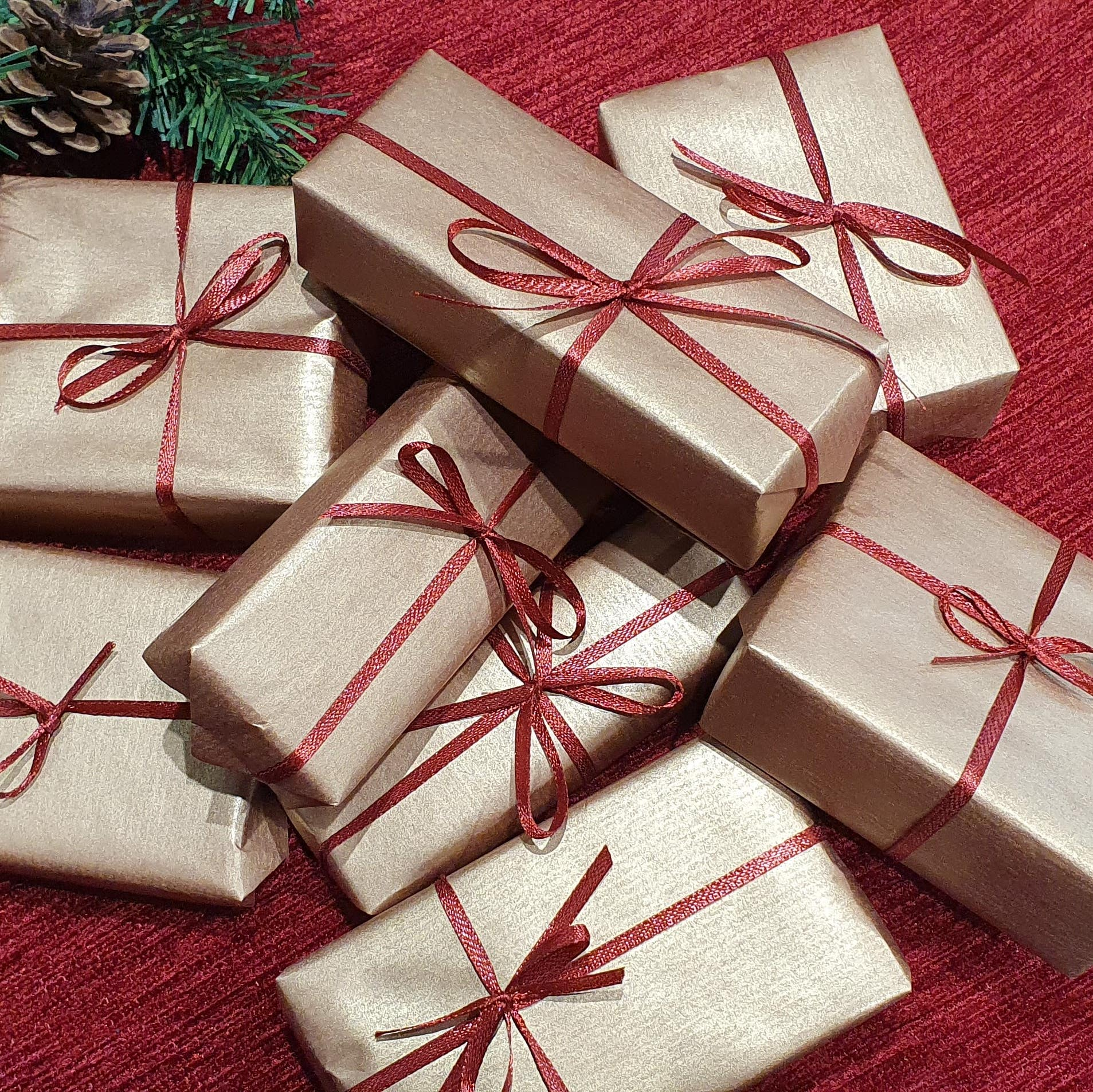 Pile of small wrapped boxes to use and tree decorations and props