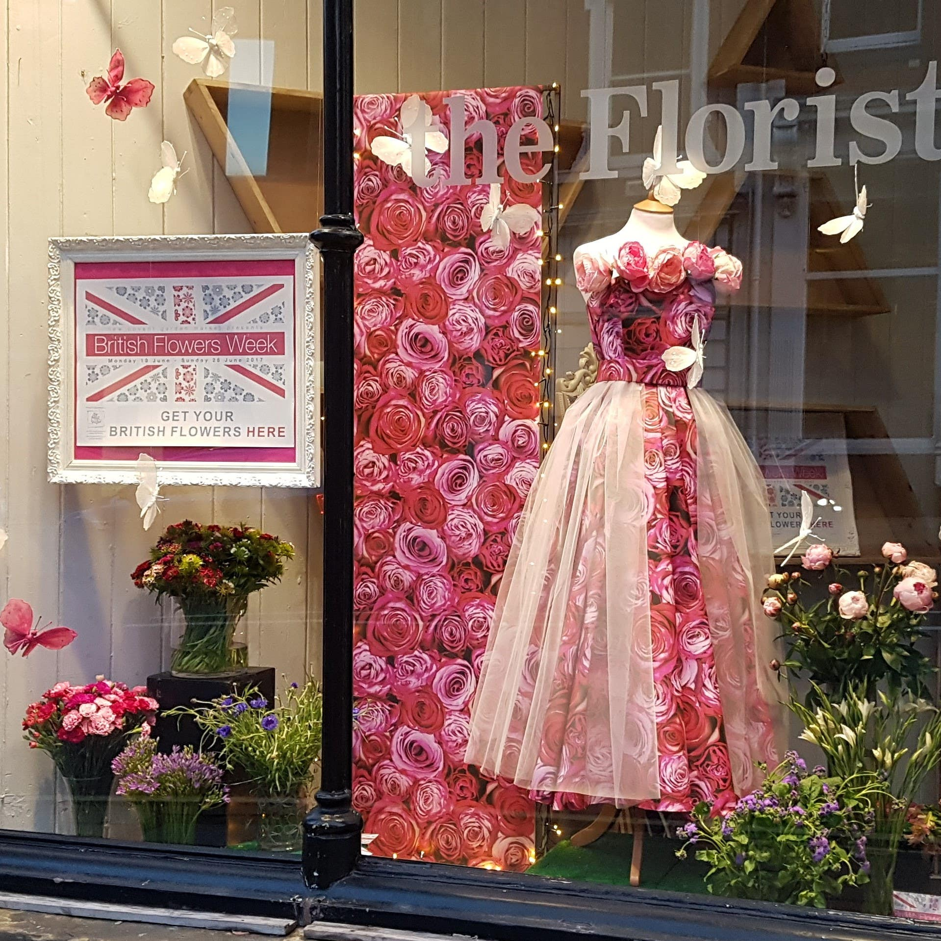 Mannequin styled in wallpaper for a florist shop to give height
