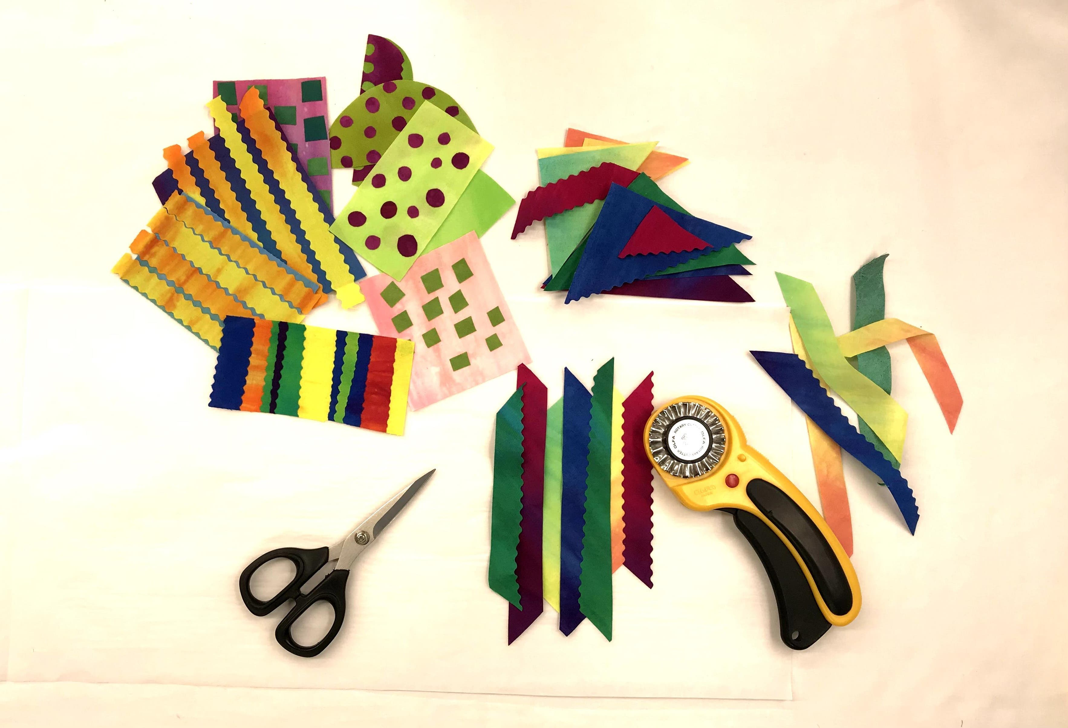 In the process of making improv collages with fused fabric that has been cut with a pinking blade