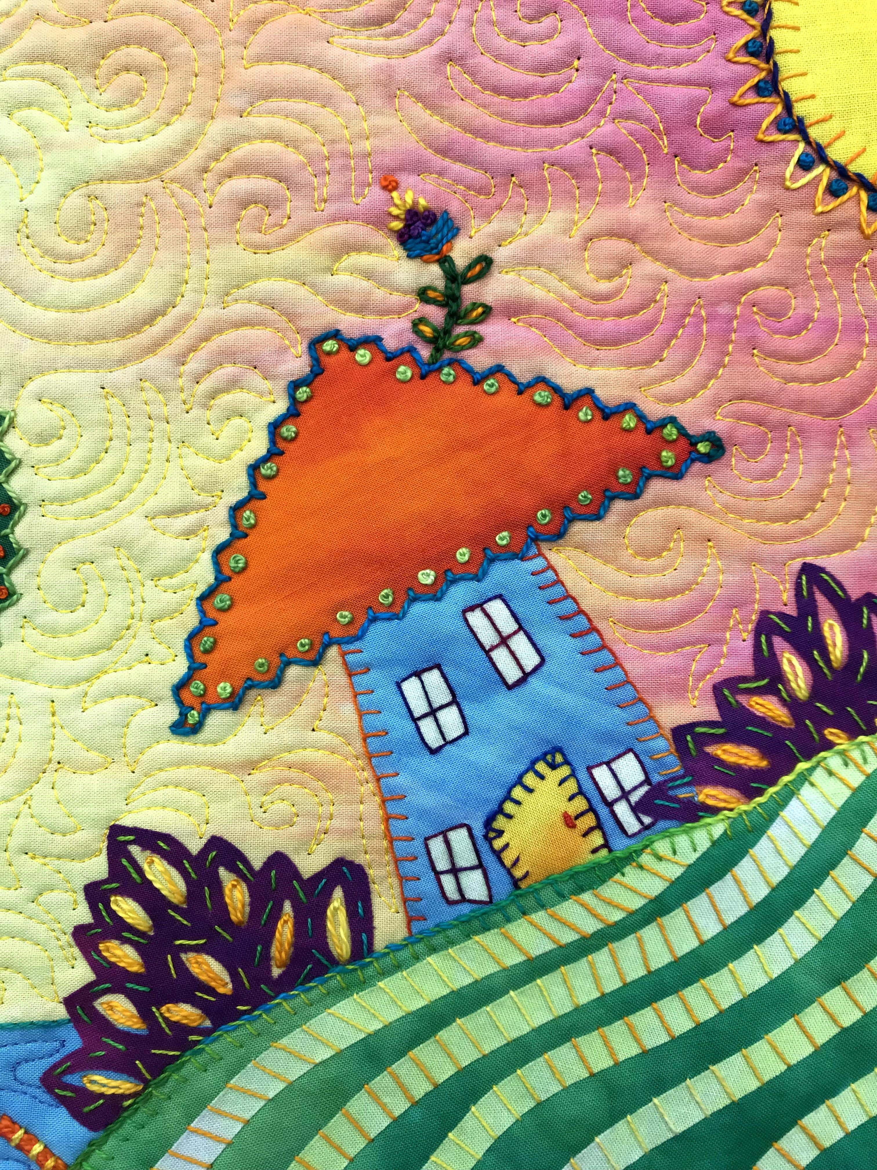 Fused and embroidered tiny home of fabric