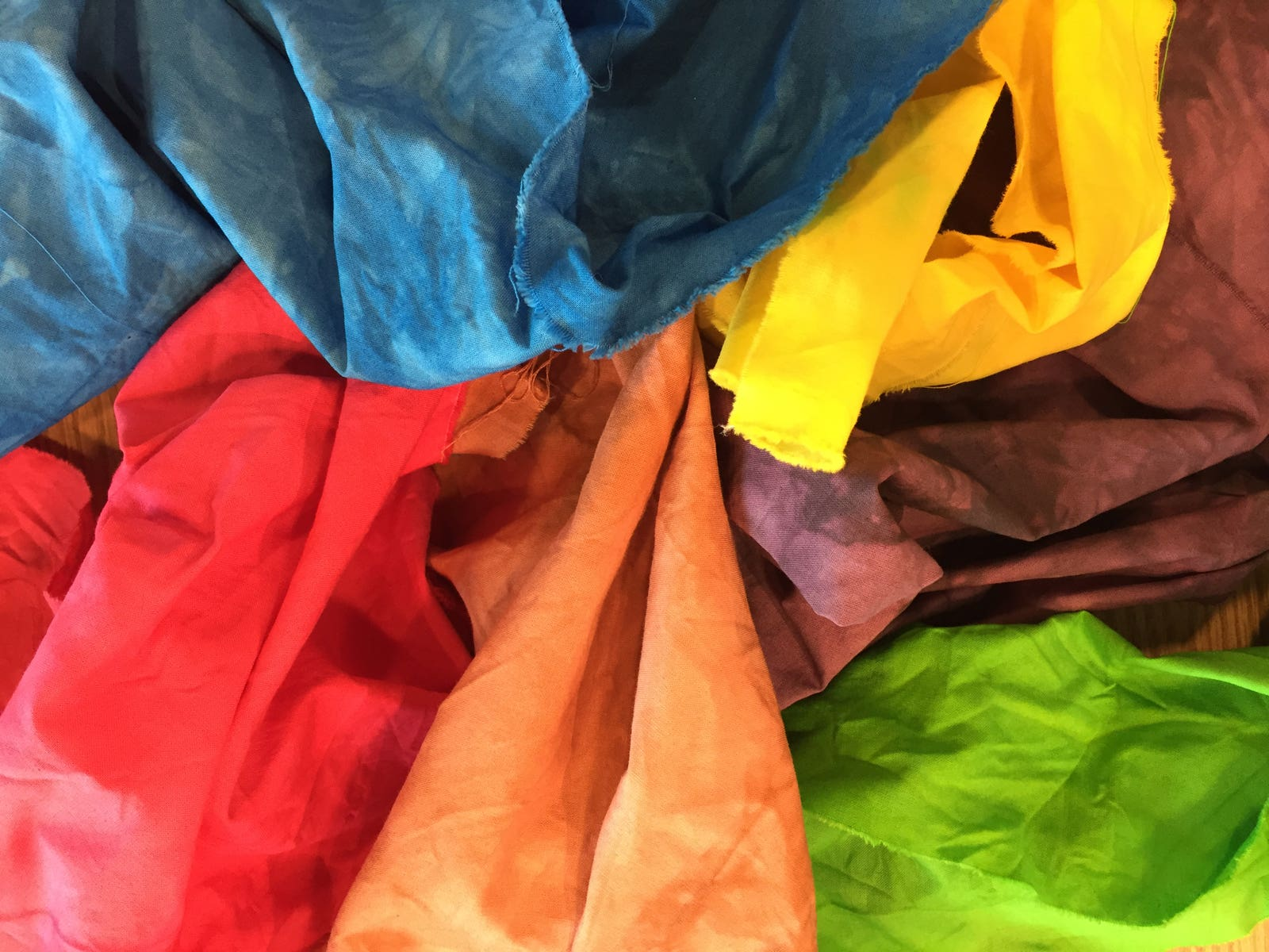 Pile of dyed fabric in various colors
