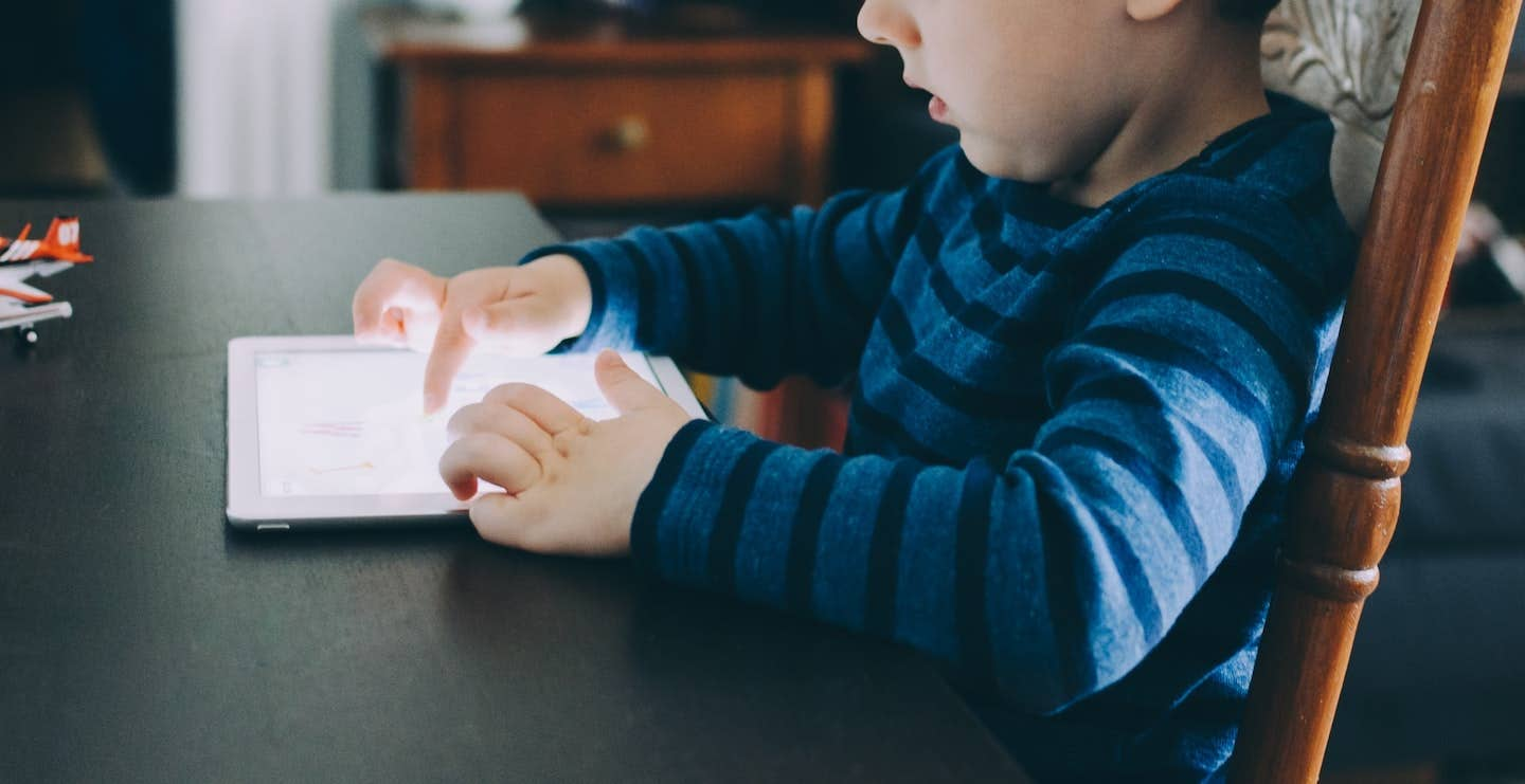 child using tablet device