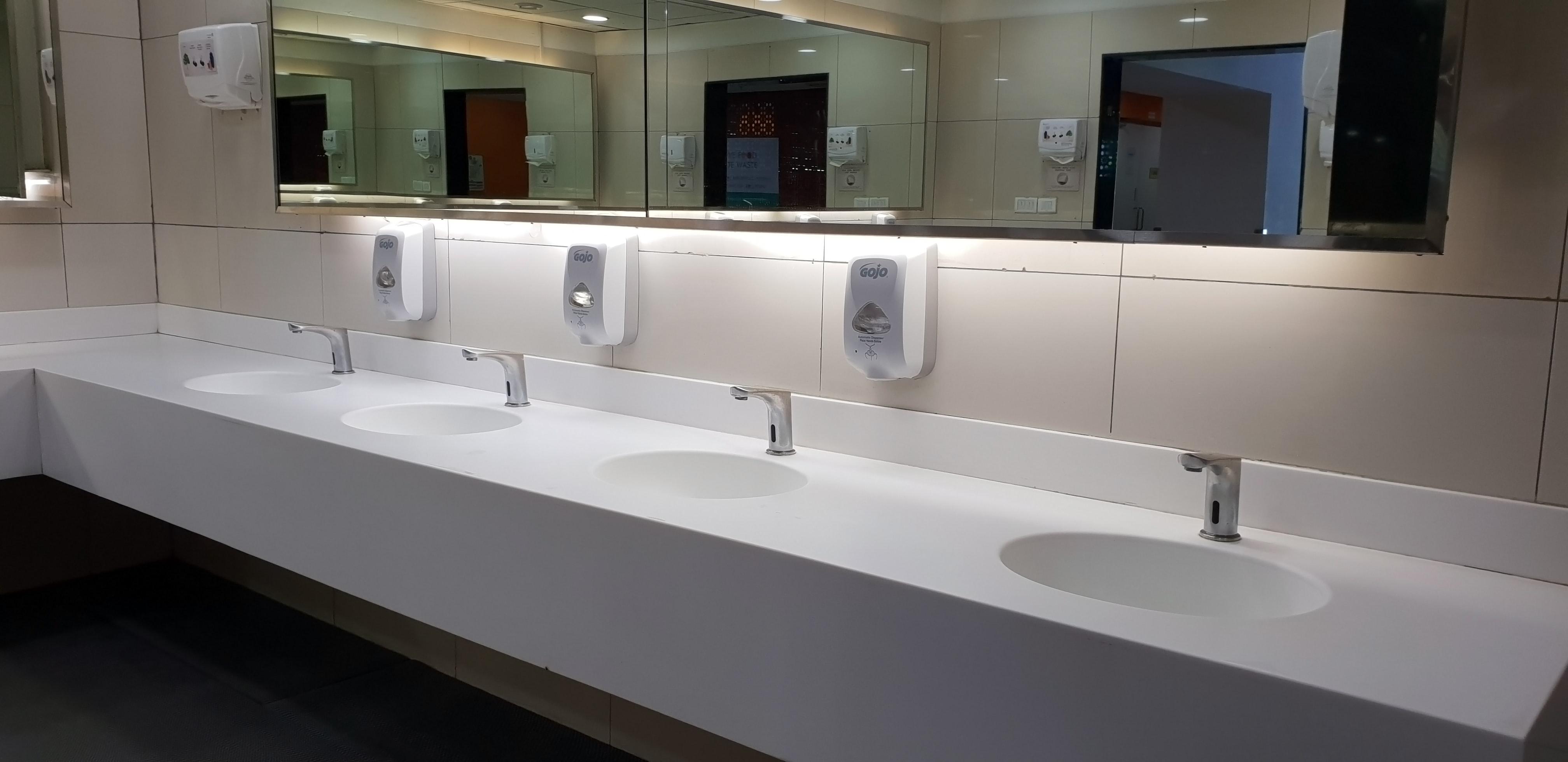 four public restroom sinks