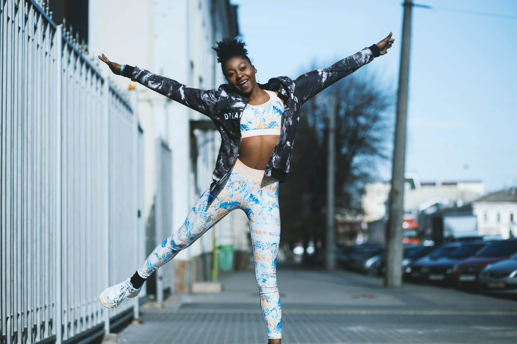 Black young woman jump vitality joy