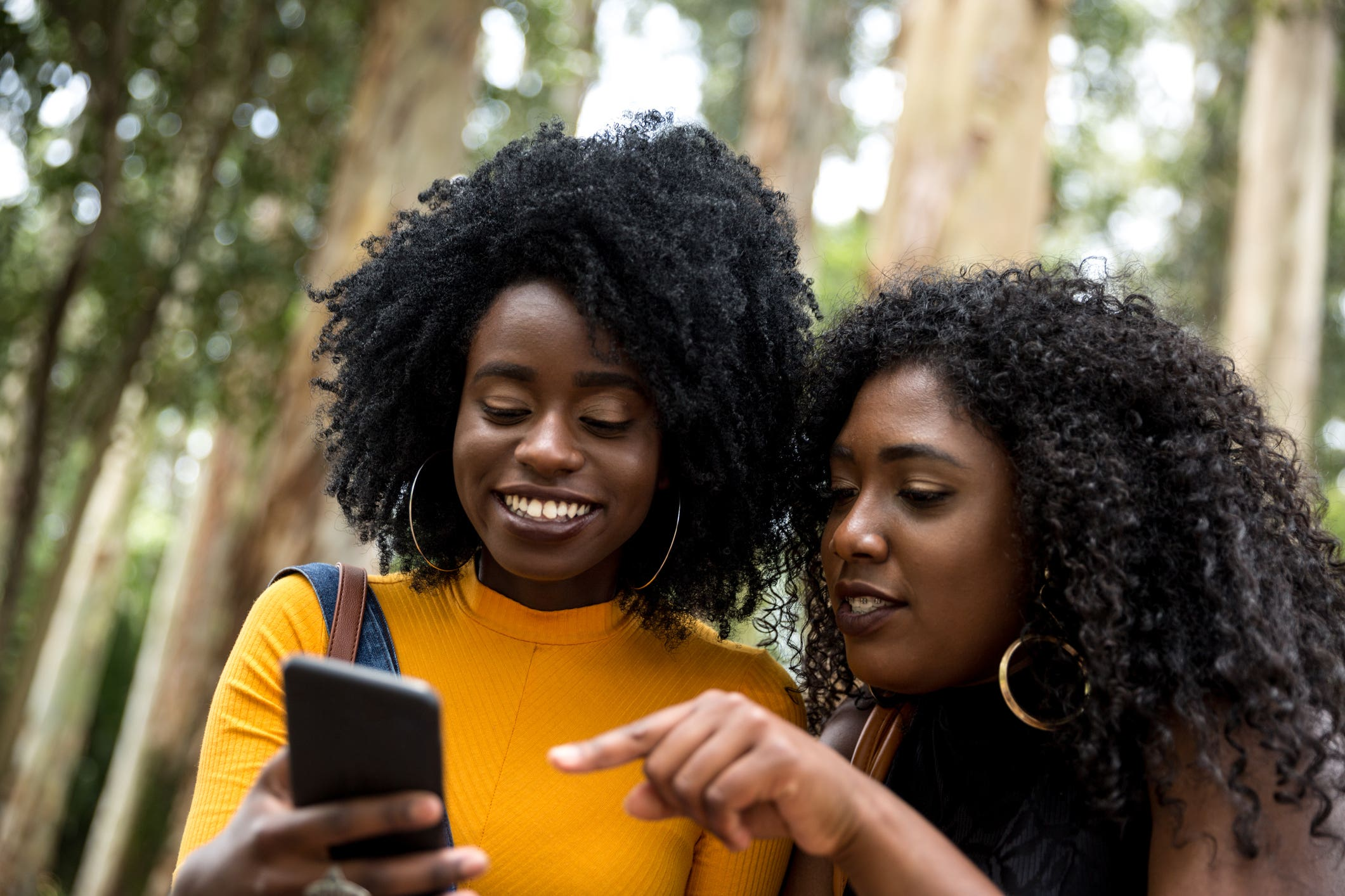 two Black women mobile phone