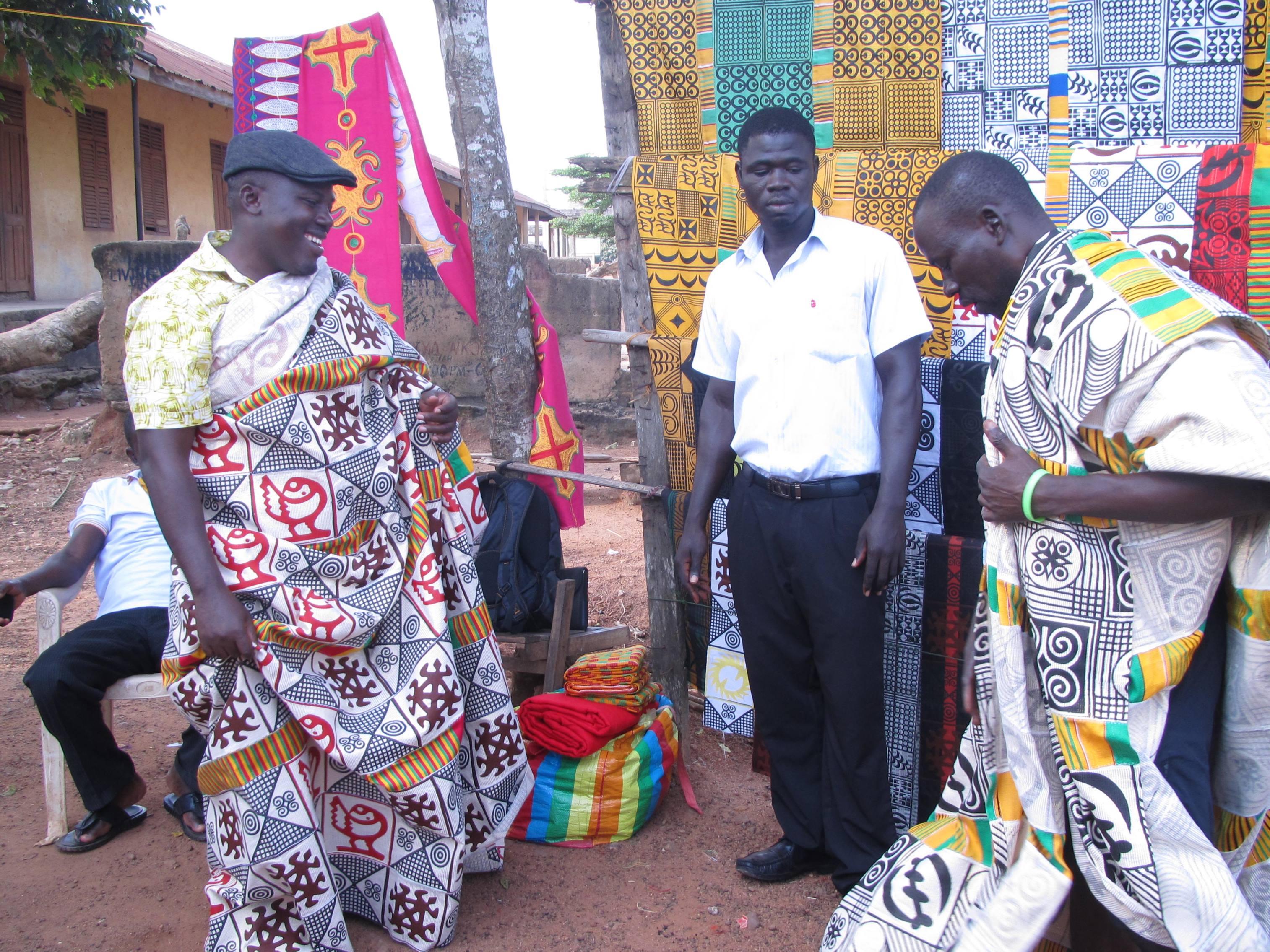 Ghanaian men choosing adinkra textiles
