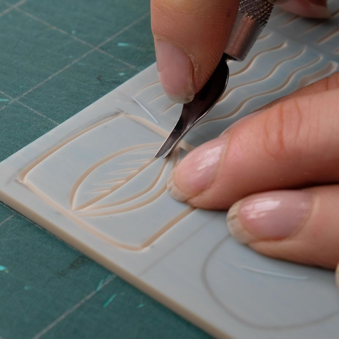 Learn how to carve a variety of mark making techniques using linocut tools