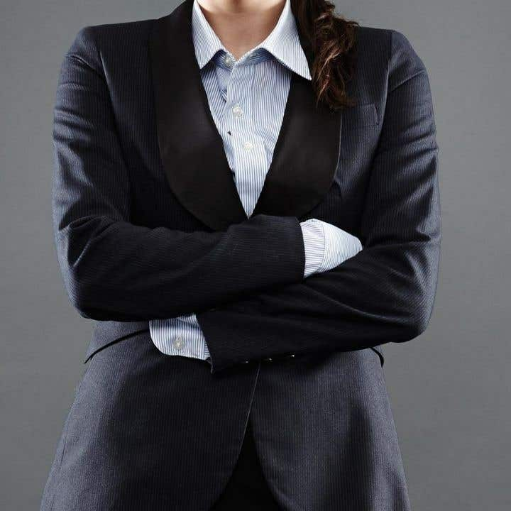 Woman in a suit with her arms crossed