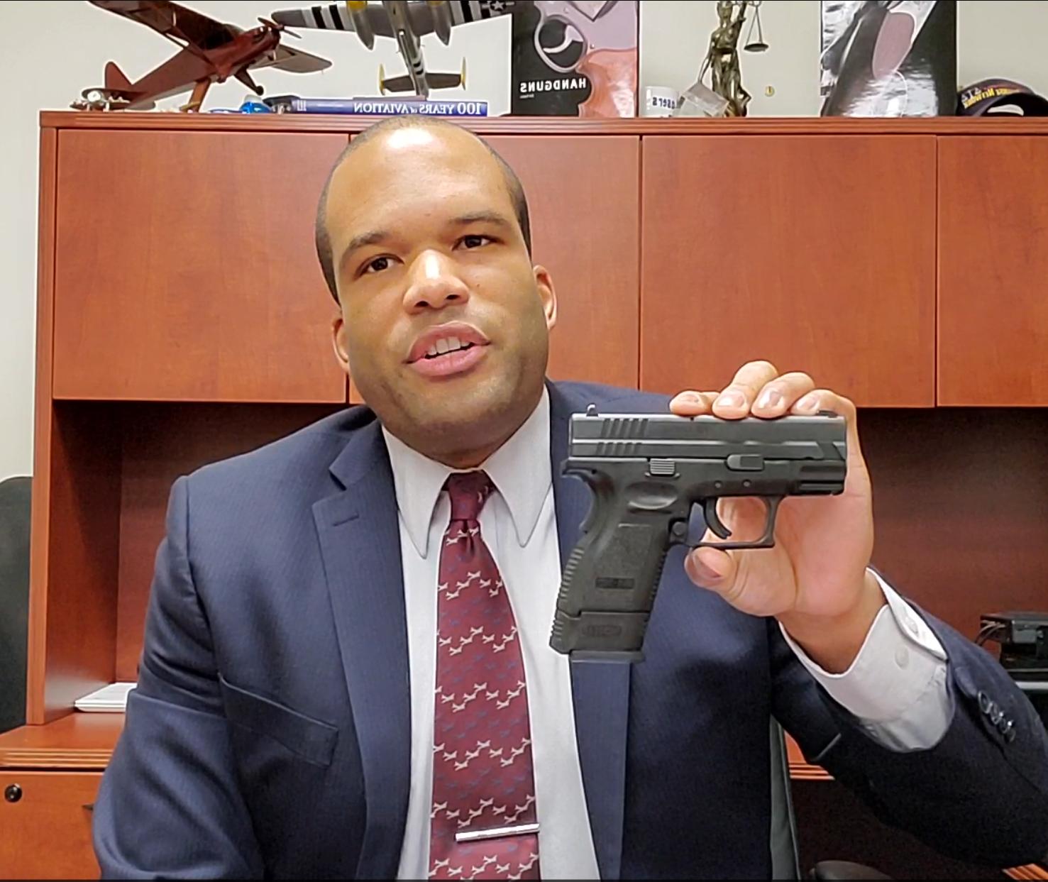 Instructor holding a handgun