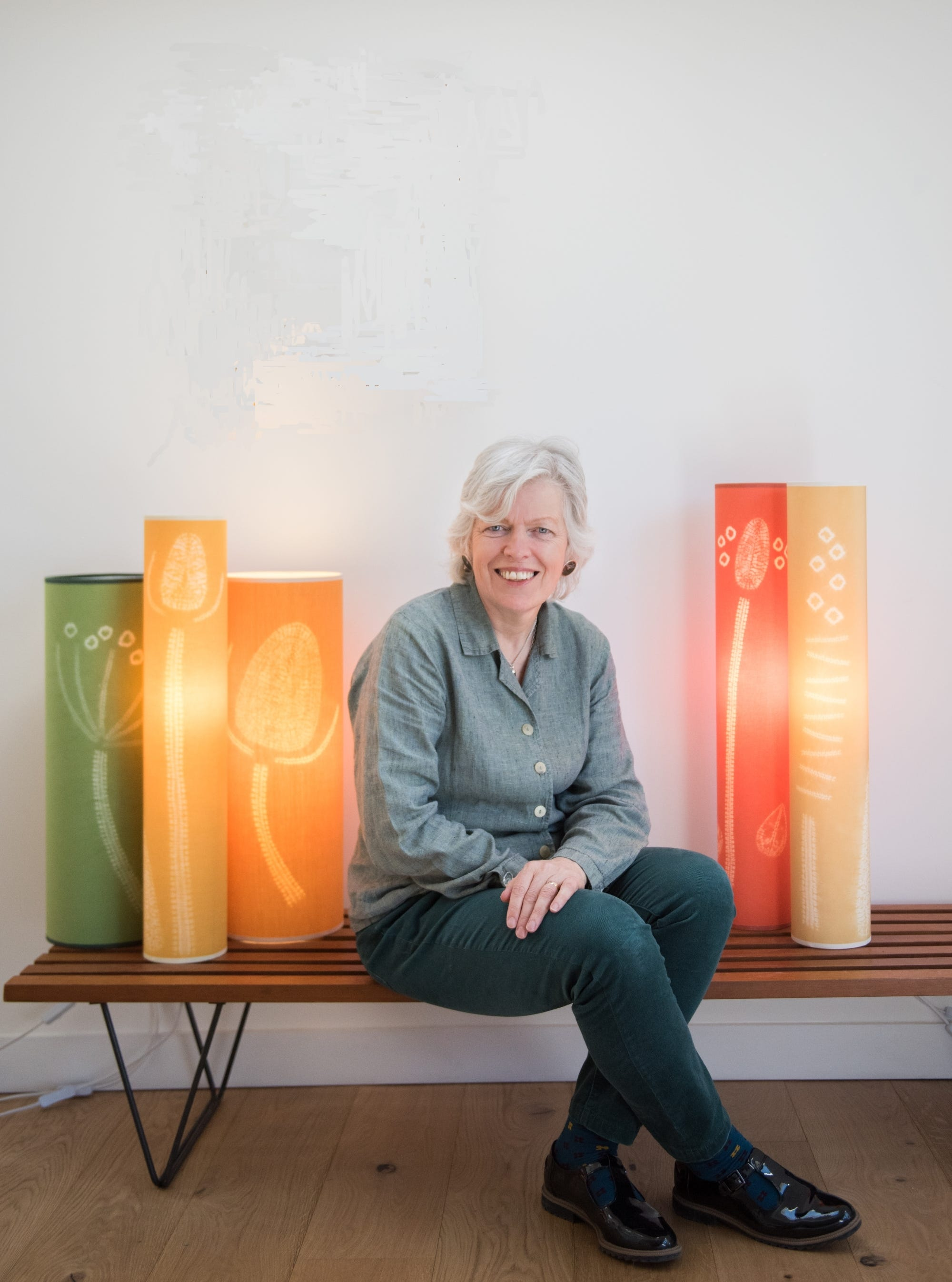 Annabel Wilson surrounded by her textile lamps