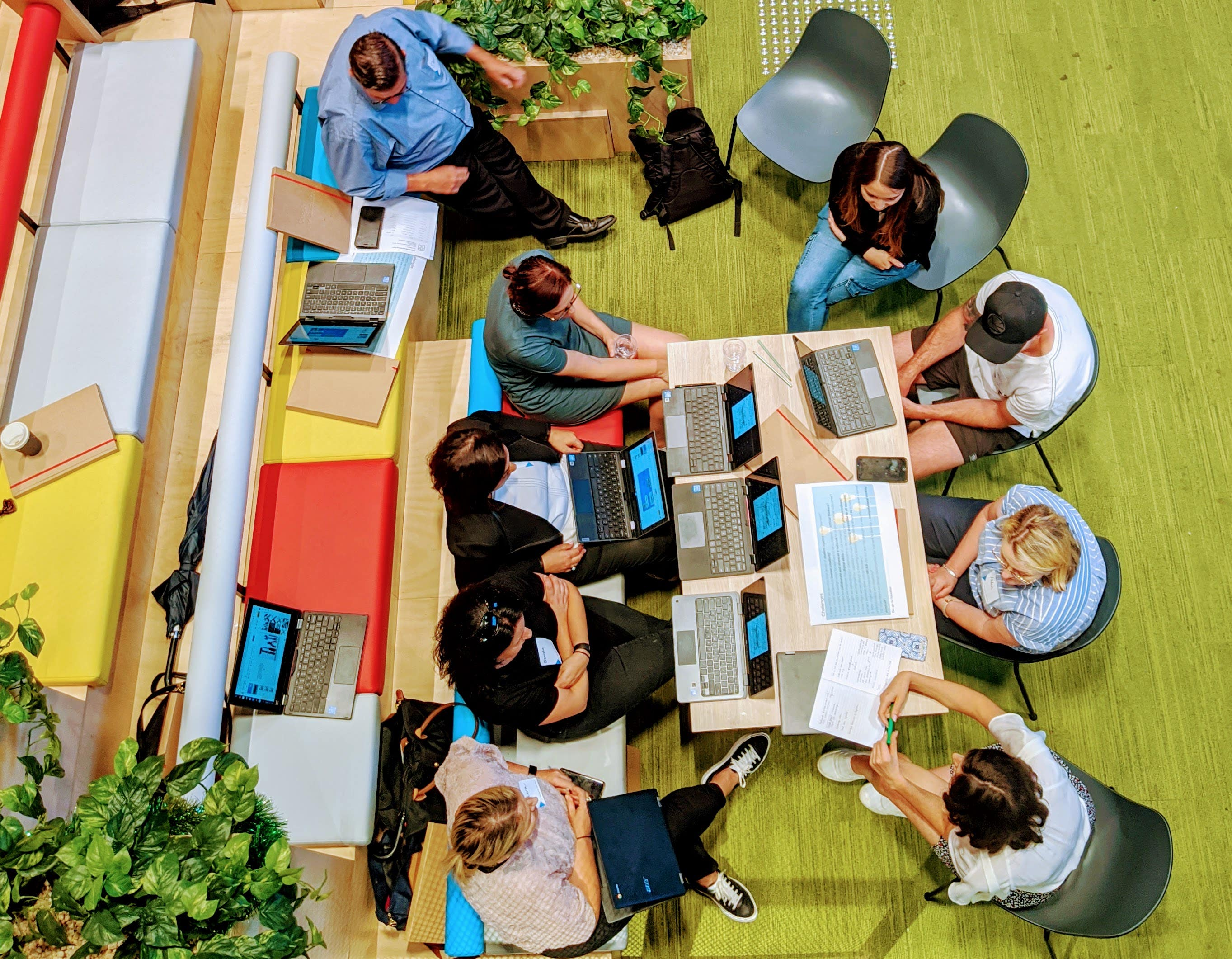 Overhead photo of a team working at Google Melbourne