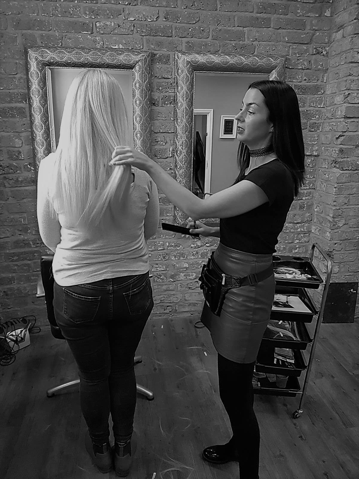 Tutor demonstrates hair extension installation