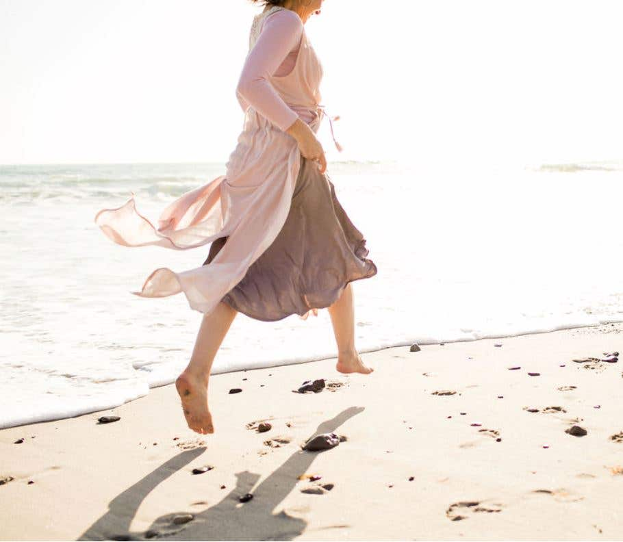 Feeling freedom running on the beach