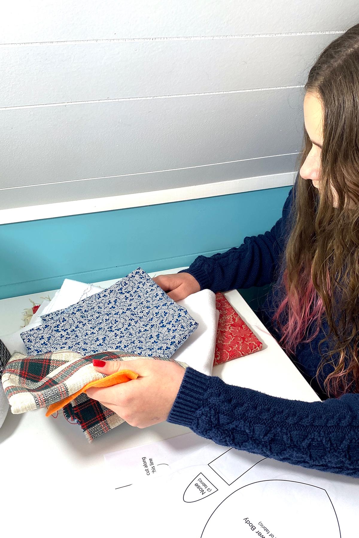 Girl cutting fabric