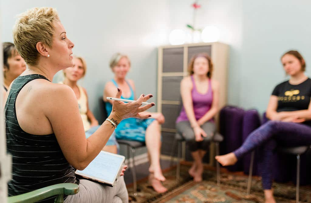 Gretchen with a small group health coaching group at bee yoga fusion