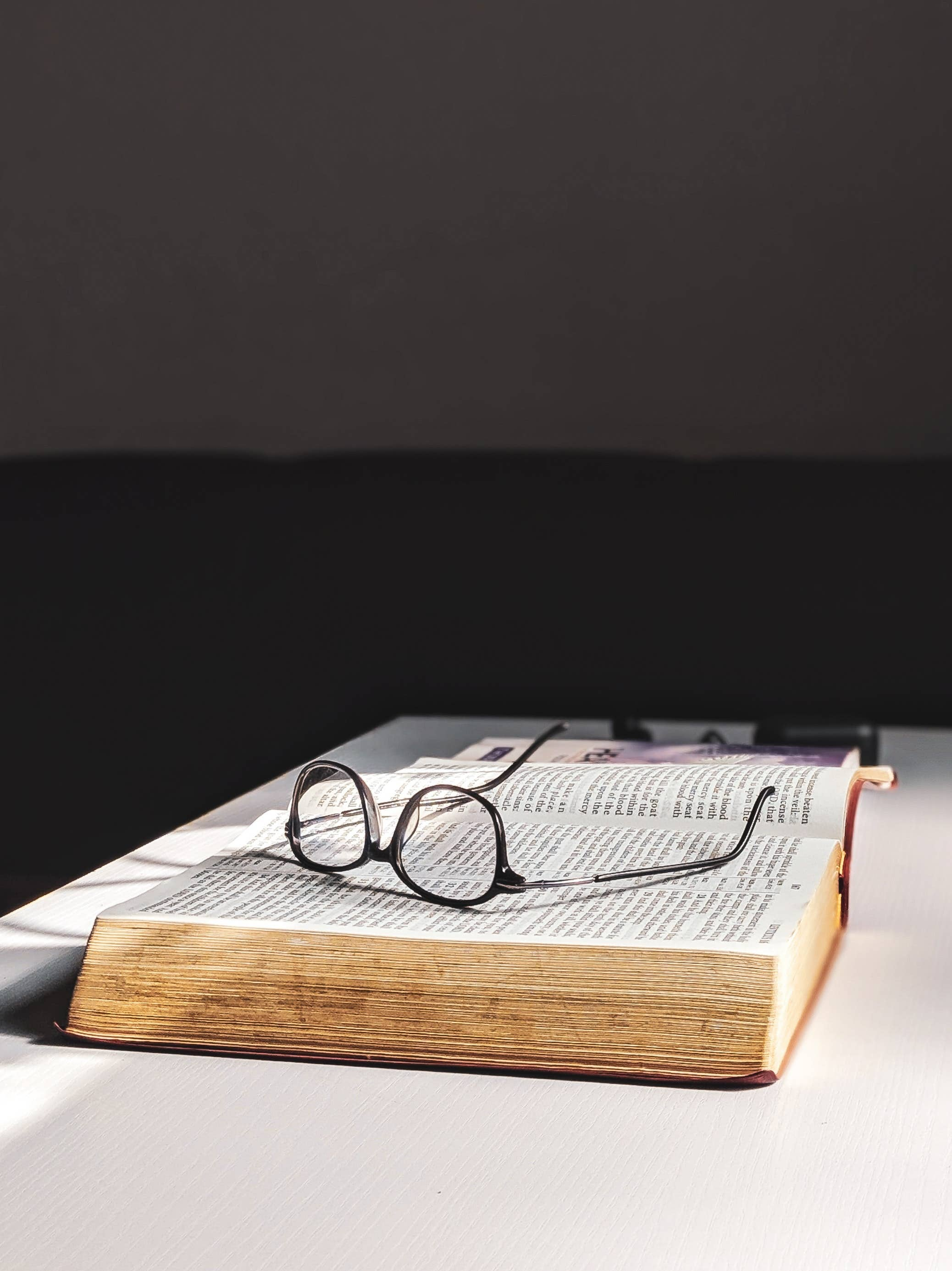 Eyeglasses on an opened book