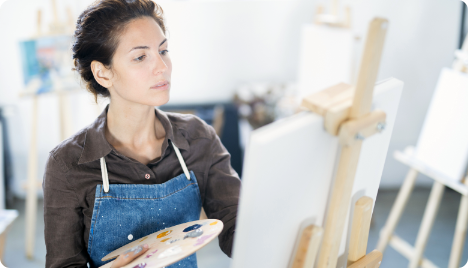 Woman painting - unlocking her potential