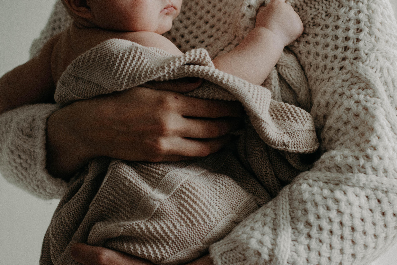 Parent holding infant