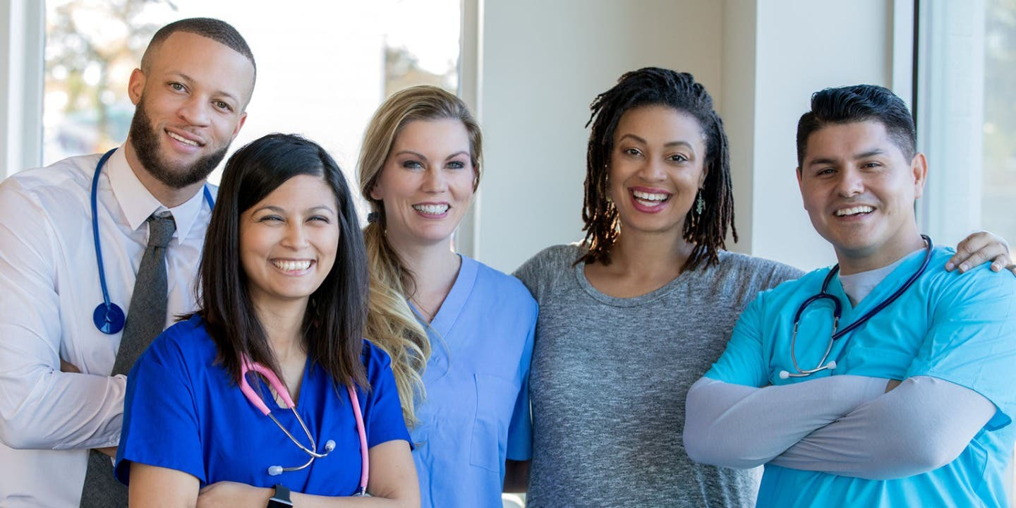 Group of NHS workers smiling
