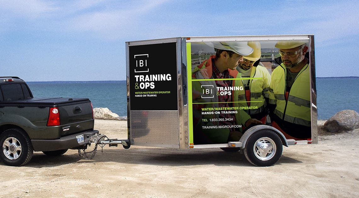 Truck pulling a trailer with IBI Training & Ops branding
