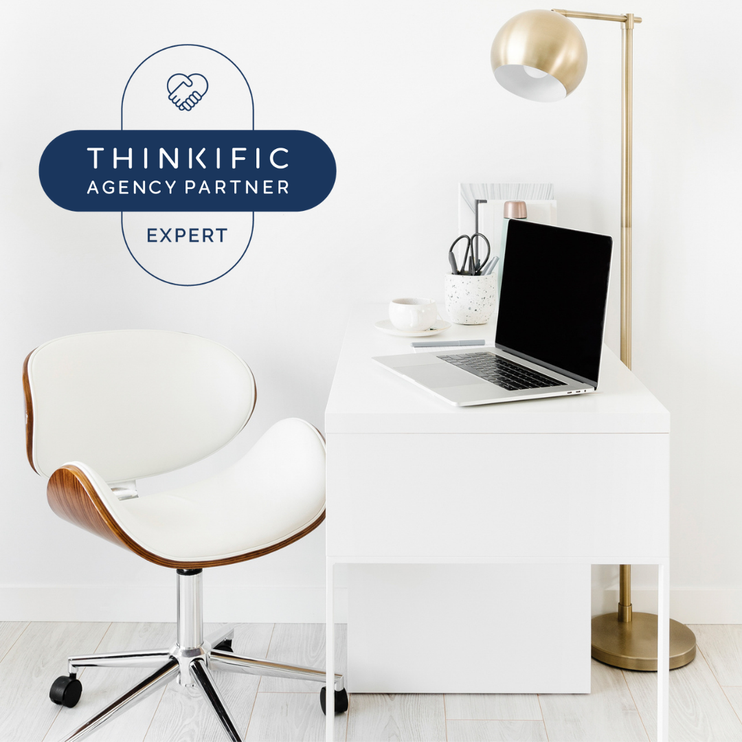 Image of a desk , chair and laptop with the words Thinkific Agency Partner Expert